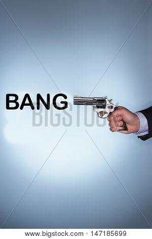 Gun with the text saying bang