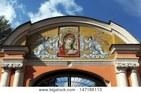 Saint Alexander Nevsky Lavra or Saint Alexander Nevsky Monastery. Mother of God Icon of Mary and angels at the main gate of the monastery. Russia, Saint-Petersburg