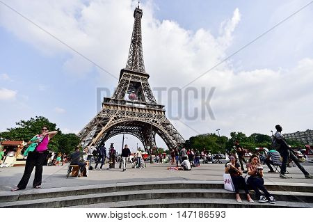 PARIS FRANCE - JUNE 8: Giant soccer ball suspended on the Eiffel Tower during the UEFA 2016 European Championship on June 8 2016 in Paris.