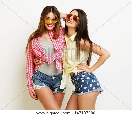 Two fashion laughing painted girl friends hugging and having fun