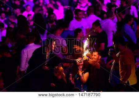 Man Holding Burning Torch At A Live Concert