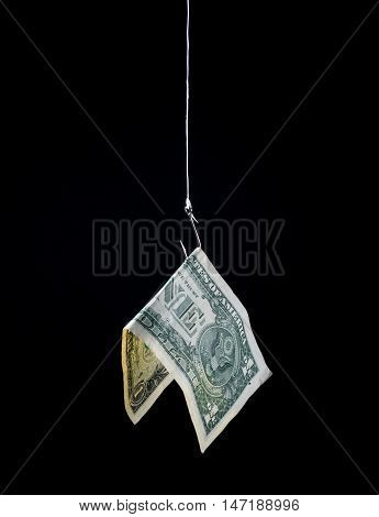 money hanging on a fish hook as bait - concept image - risk profit loss investment etc.
