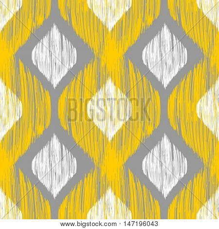 Ikat yellow, white and grey rhomb seamless pattern. Ethnic background for textile, web and print design