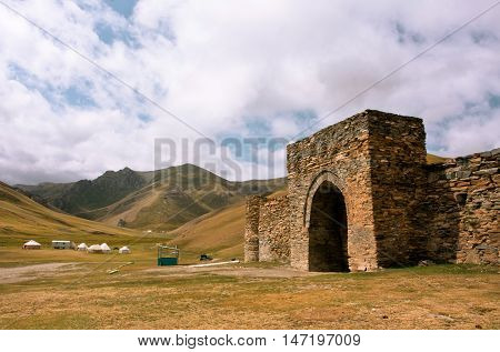 Entrance to the stone fortress and ancient hotel Tash Rabat, Kyrgyzstan. The best preserved Silk Road site. It is the largest structure built of stone from Central Asian architecture from 15th century