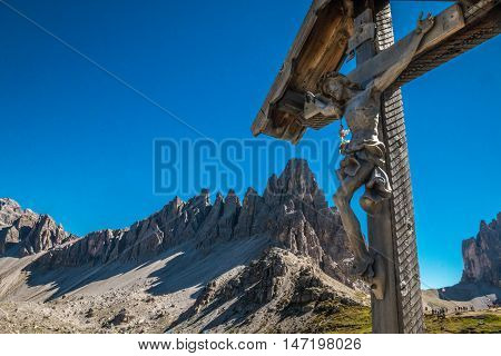 A cross in Dololites mountains in Italy