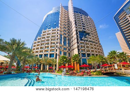 ABU DHABI, UAE - MARCH 28, 2014: Pool area of resort Khalidiya Palace by Rotana in Abu Dhabi, UAE. Rotana Hotel Management Corporation has 85 properties in 26 cities around Middle East and Africa.