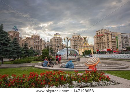 Kiev Ukraine - June 16 2016: Citizens have a rest on the Independence Square on the eve of a thunderstorm