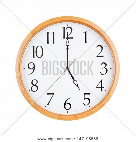 Exactly five o'clock on a large round dial