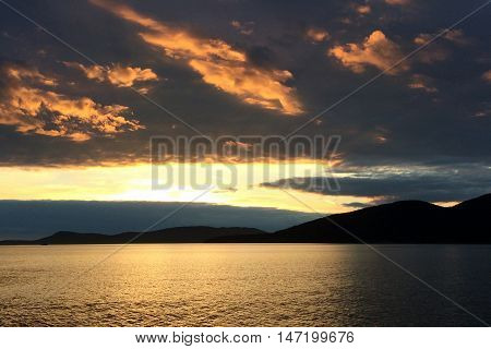 A sunset on Puget Sound with golden clouds