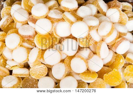 Group of gummy round of color yellow and white