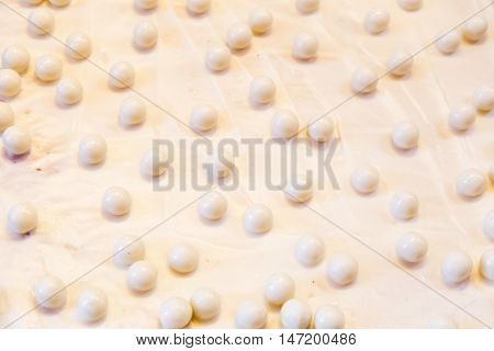background white chocolate cheesecake with of chocolate balls over