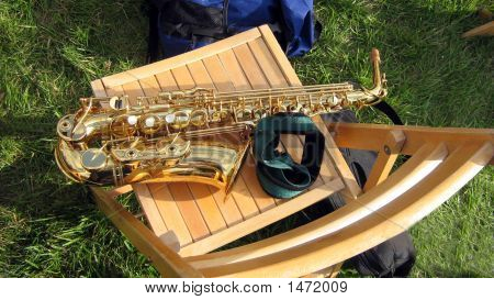 Saxaphone On A Chair . Outdoor Concert. Wind Instrument