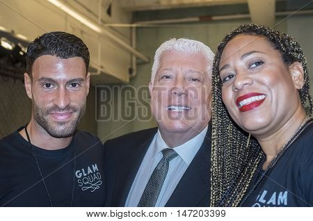 New York NY USA - September 13 2016: Designer Dennis Basso poses for a photo with the Glam Squad on the backstage for the Dennis Basso Spring/Summer 2017 runway show during New York Fashion Week SS 2017 at The Arc Skylight at Moynihan Station