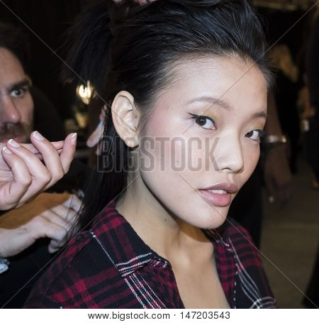New York NY USA - September 13, 2016: A model prepares backstage for the Dennis Basso Spring/Summer 2017 runway show during New York Fashion Week SS 2017 at The Arc Skylight at Moynihan Station