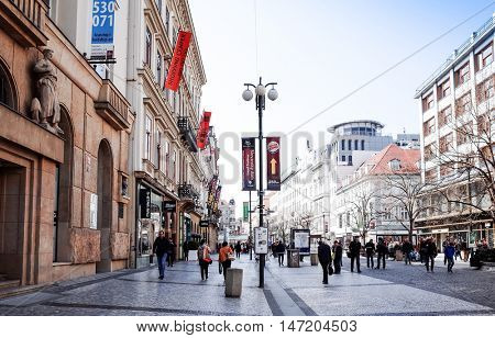 PRAGUE, CZECH REPUBLIC - April 9, 2015 : Tourists on foot Street in old town PRAGUE in Czech Republic