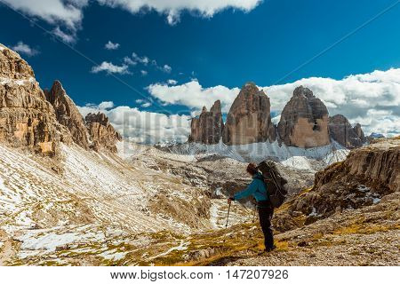 Woman hiker on top of  mountain, Dolomites, Italy