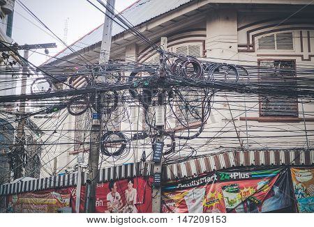 BANGKOK: September 10: The chaos of cables and wires on Chareonkrung road on September 10, 2016 in Bangkok, Thailand.