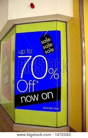 Sign On Window Of Store. Sale Up To 70% Off Now On Sign