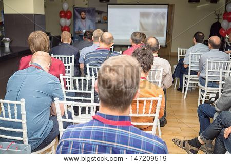 Audience In A Conference Hall During The Business Presentation