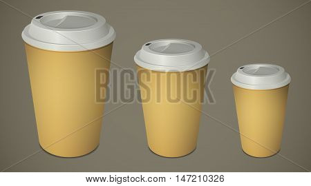 Three paper coffee cups with caps top-down view isolated on white