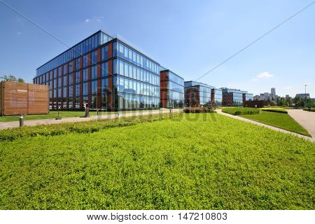 MOSCOW - JUN 03, 2015: Business center Olympia Park and lawn. Olympia Park complex has offices, sports complex and park