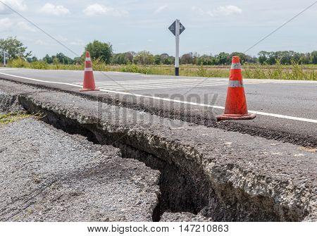 danger of Collapsed Asphalt Road Cracked and Broken.