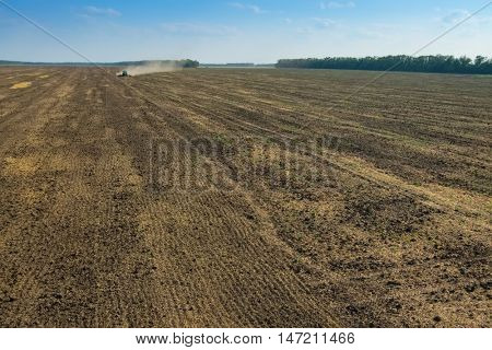 KRASNODAR REGION, RUSSIA - AUG 19, 2015: Tractor plow big field, In 2015 in Krasnodar region have collected record grain harvest - 102 million tons of grain
