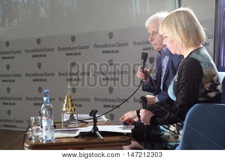 RUSSIA, MOSCOW - APR 6, 2015: Valery Kitchin sitting next to woman and speaking into microphone on VI online film festival Dubl dva.