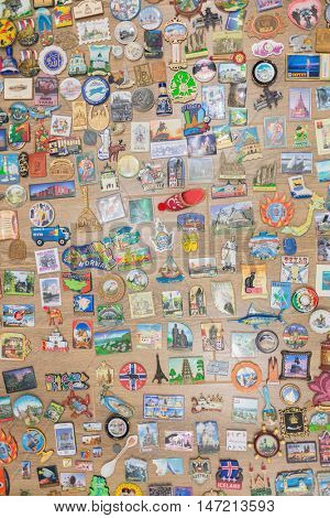 MOSCOW - FEB 10, 2015: Souvenir magnets from different cities and countries are on table, above view