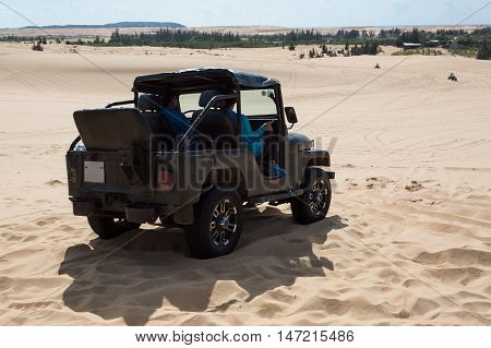 off road car vehicle in white sand dune desert at Mui Ne Vietnam