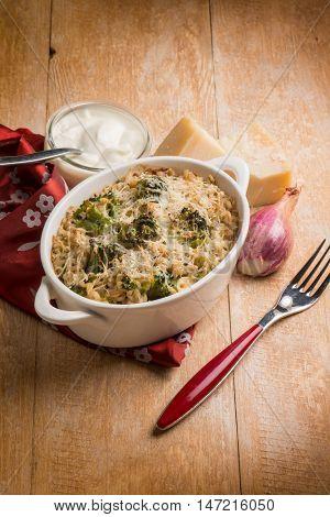 barley gratin with broccoli parmesan cheese and bechamel