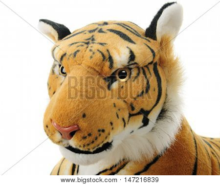 Close-up image of a toy tiger's face.  On a white background.
