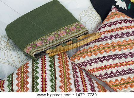 Green bag and orange cushions with the Slavic ornaments