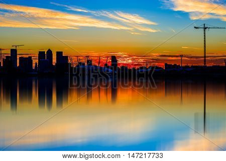 Silhouette of Canary Wharf financial district of London at sunset