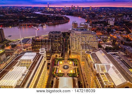 London Skyline At Sunset, Aerial View With Canary Wharf