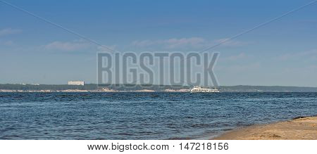 Photo of Tourist boat floats on the Volga river. Cheboksary. Russia.
