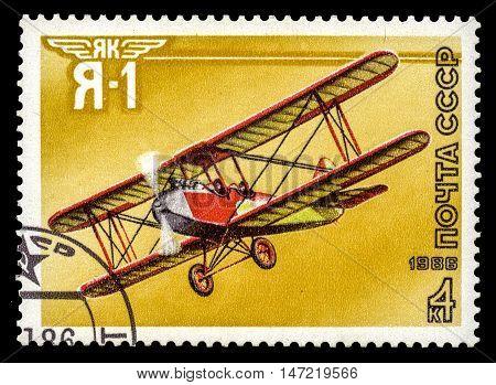 USSR - CIRCA 1986: A stamp printed in the USSR show airplane Yak Ya-1 series