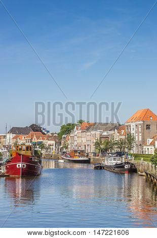 ZWOLLE, NETHERLANDS - AUGUST 31, 2016: Canal with old ships and historical houses in Zwolle, Netherlands