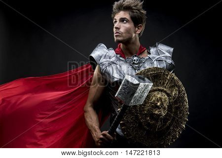 centurion or Roman warrior with iron armor, military helmet with horsehair and hammer