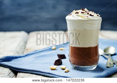 Peanut butter chocolate mousse parfait on wood background