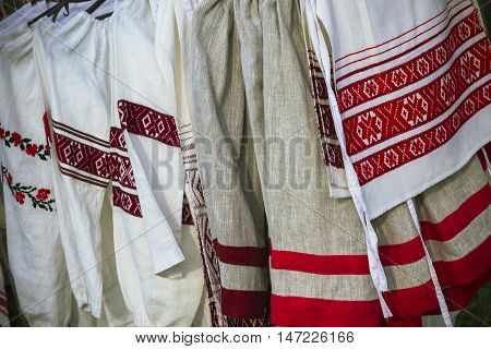 traditional Slavic clothes with national ornaments shirts and skirts