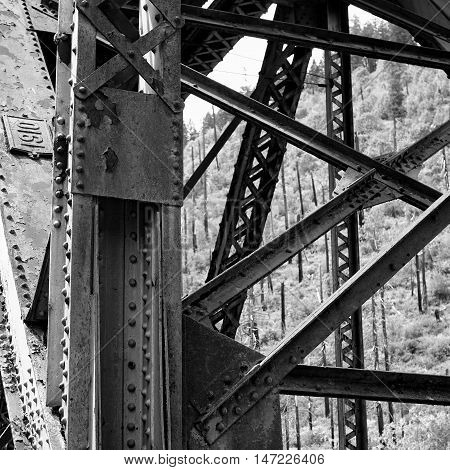 An old bridge in Westfir Oregon that was built in 1910 is rusted but still standing strong.