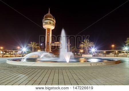 HIDD, BAHRAIN - SEPTEMBER 10, 2016: Night shot of the beautiful fountain and the coffee house tower in Prince Khalifa Bin Salman Park
