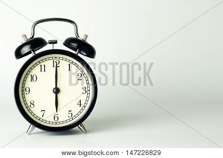 Alarm Clock isolated on white showing six o'clock.