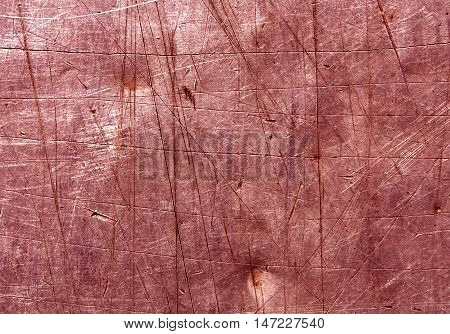 Red Scratched Metal Surface.