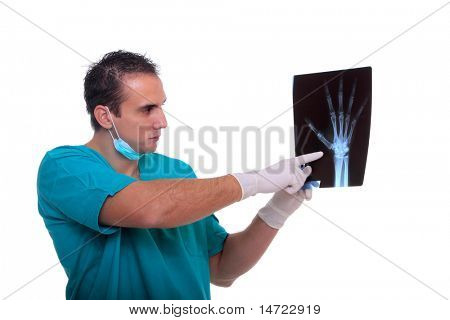 doctor looking at an xray of the hand- isolated over a white background