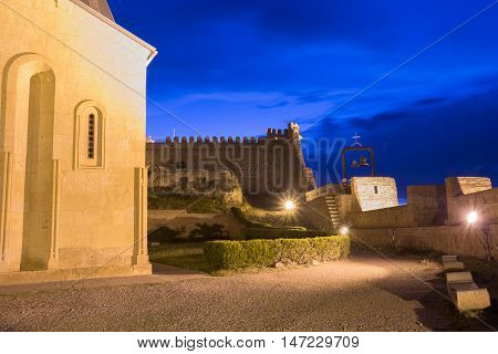View The Inner Side Of Wall Of The Ancient Fortress Narikala In Evening llumination Under Blue Cloudy Sky, Tbilisi, Georgia.