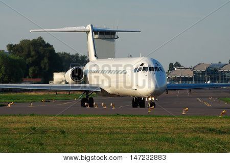 Kiev Ukraine - July 27 2012: McDonnell Douglas MD-83 (DC-9-83) passenger plane is taxiing to the runway for takeoff