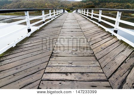 Wooden structure Penmaenpool toll bridge over the River Mawddach near Dolgellau Wales United Kingdom