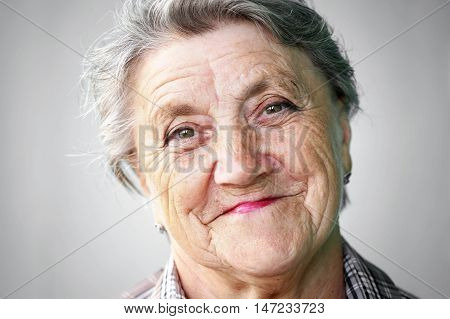 Smile granny face on a gray background